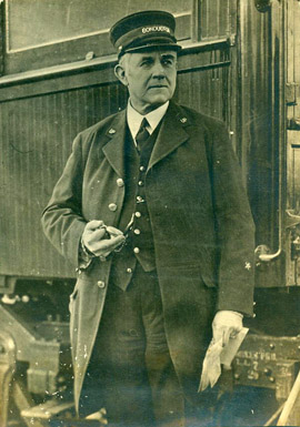 UP Conductor checks time, W.T. Horne photograph