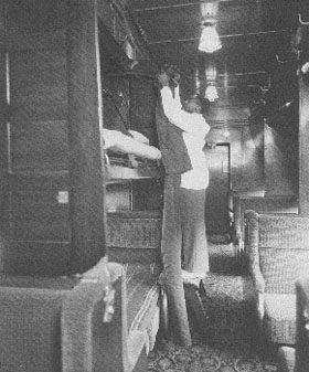 Pullman Porter makes a bed (New York Central photo)