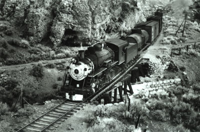 V&T Locomotive No. 5 pulls a train along the main line track through a canyon